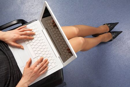 Above view of businesswoman typing on laptop in office photo
