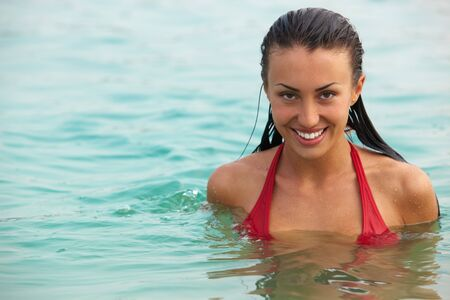 Portrait of wet attractive woman in water photo