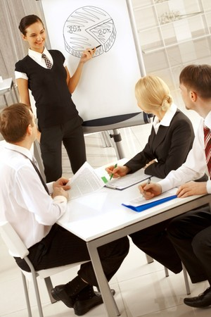 happy businesswoman sharing her ideas by whiteboard with partners Stock Photo - 7553040