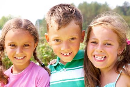 boy friend: Portrait of happy preschoolers looking at camera outside