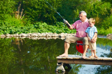 grandchild: Photo of grandfather and grandson on pontoon fishing on weekend