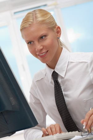 Image of young employer looking at computer monitor in office Stock Photo - 7601919