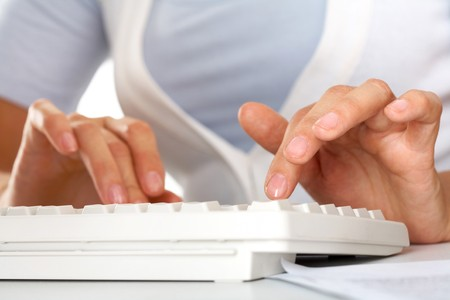 Human hands over keypad buttons during typing photo