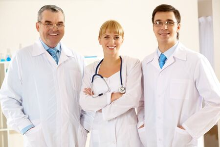 Portrait of friendly therapists standing in line and looking at camera with smiles Stock Photo - 7601874