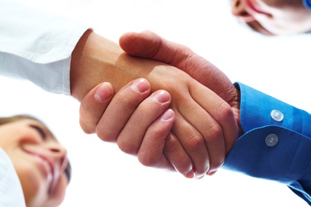 partners: Image of partners handshake after signing contract