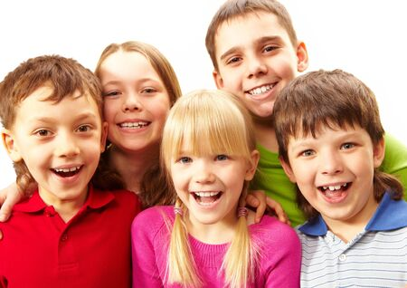 brothers and sisters: Image of young boys and girls smiling at camera Stock Photo