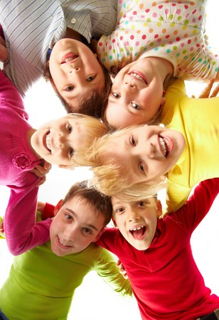 Image of happy kids embracing and laughing in circle Stock Photo - 7602179