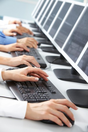 Image of female hand typing in computer classroom photo