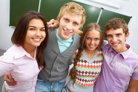 Portrait of happy teens embracing and looking at camera with smiles photo