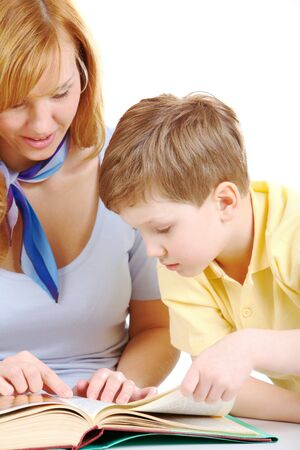 Photo of cute preschooler and his mother looking into book Stock Photo - 7645846