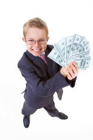 Portrait of happy boy with dollar bills looking at camera Stock Photo - 7645919