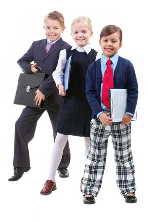 Portrait of three children in smart clothes looking at camera photo