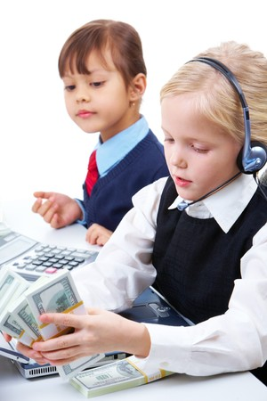 Photo of serious girl with headset counting dollars on background of attentive partner photo