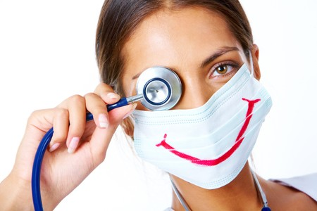 the medic: Portrait of assistant in mask with big smile on it looking at camera Stock Photo