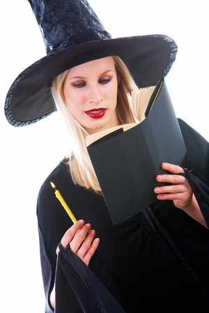 antichrist: Portrait of young witch reading black book with attention Stock Photo