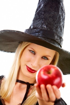 antichrist: Image of witch giving red ripe apple to somebody Stock Photo