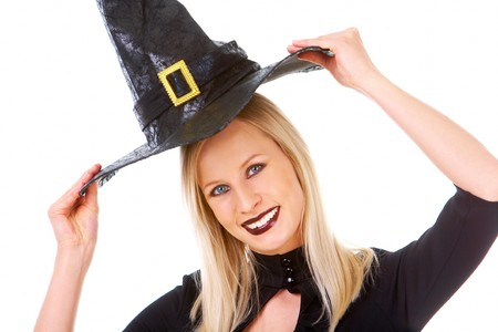 Portrait of young female putting off black hat and keeping it over head Stock Photo - 7695335