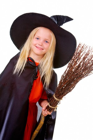 Portrait of girl in witch costume looking at camera photo