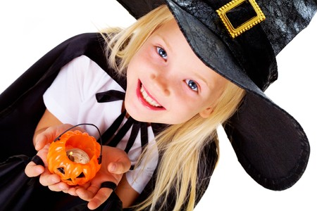 repent: Portrait of girl in witch costume and small pumpkin candle in hands