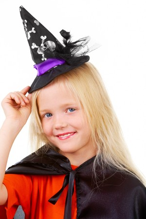 Portrait of girl in witch costume posing before camera Stock Photo - 7695374
