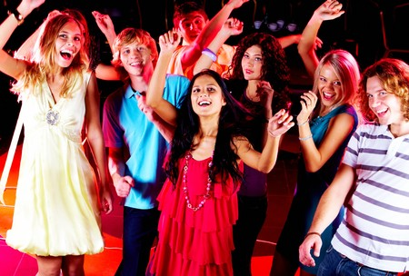Joyful teens dancing in night club at party Stock Photo - 7695326