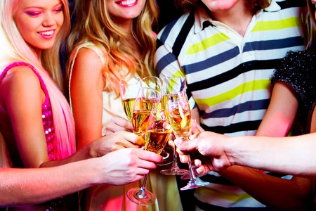 Portrait of boozing young people toasting at party Stock Photo - 7695296