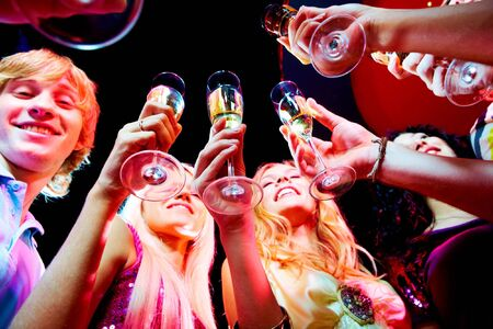 Image of boozing young people with champagne flutes toasting at party Stock Photo - 7695295