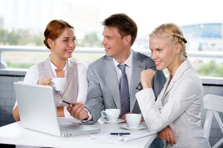 competitive business: Image of businesspeople discussing new project or plan at meeting Stock Photo
