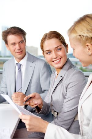interacting: Image of successful businesspeople discussing plan at meeting in office Stock Photo