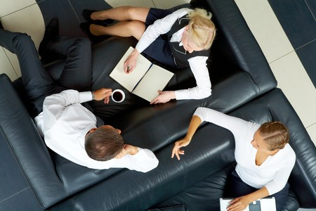 Image of company of successful partners discussing business plan at meeting Stock Photo - 7695421