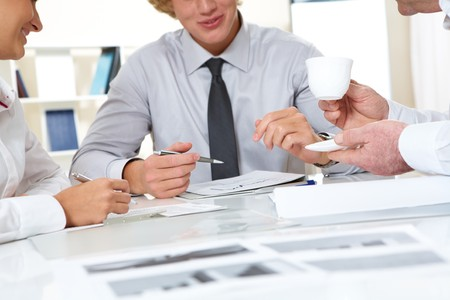 Close-up of businesspeople discussing plan at meeting Stock Photo - 7695473