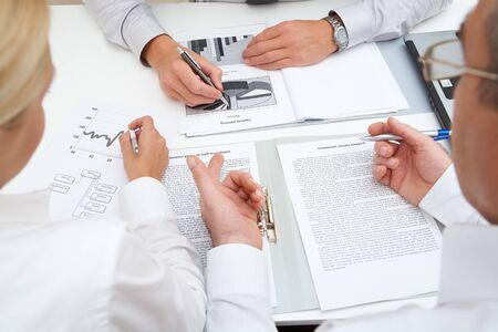 meeting place: Image of workteam working with documents at business meeting Stock Photo