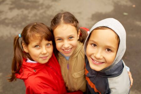 Portrait of happy kids in casual clothes looking at camera Stock Photo - 7695474