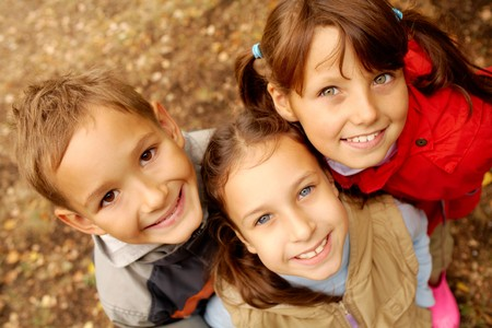 child charming: Portrait of happy friends looking at camera with smiles