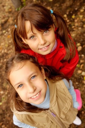 Portrait of two happy girls looking at camera with smiles Stock Photo - 7695549