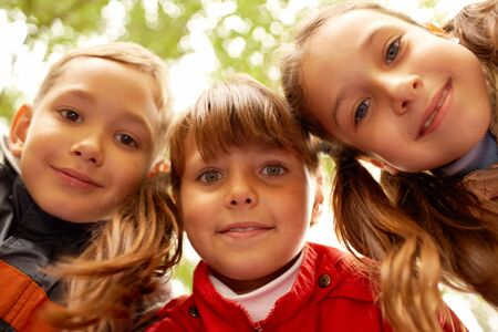 Portrait of happy friends looking at camera with smiles Stock Photo - 7695547