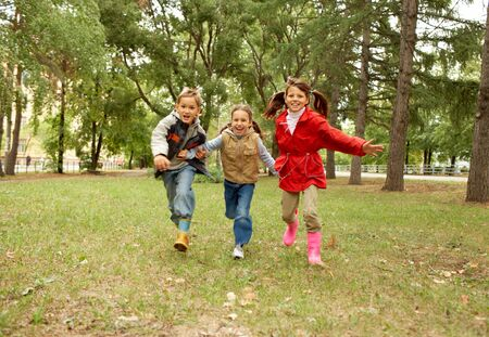 Portrait of happy kids running together in autumnal park Stock Photo - 7695571