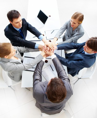 Above view of business people with their hands on top of each other Stock Photo - 7695506