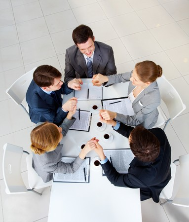 Above view of business people holding each other by hands Stock Photo - 7695480