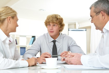 Portrait of three businesspeople interacting at meeting  photo