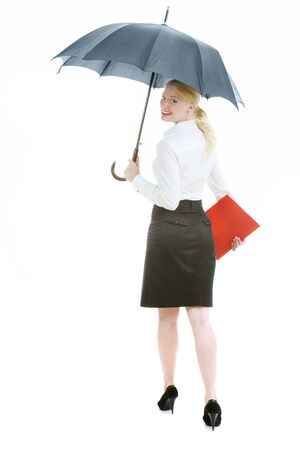 Happy woman with umbrella looking  at camera in isolation photo