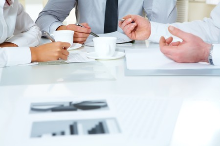 business consulting: Close-up of businesspeople discussing plan at meeting  Stock Photo