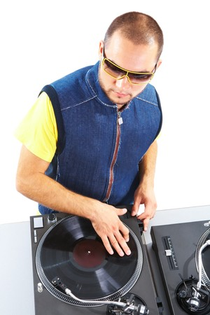 Portrait of smart deejay spinning turntables photo