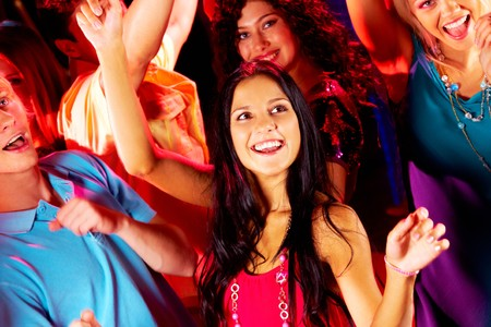 Joyful teens dancing in night club at party Stock Photo - 7695869