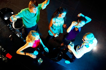 angle bar: Image of happy teenagers dancing during party in the bar