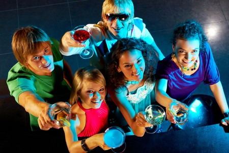 Portrait of smart young people toasting in the nightclub Stock Photo - 7695891