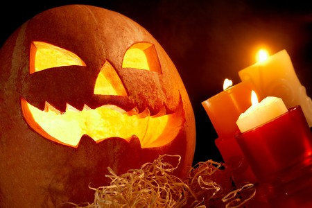 antichrist: Image of big pumpkin with burning candle inside and three candles near by