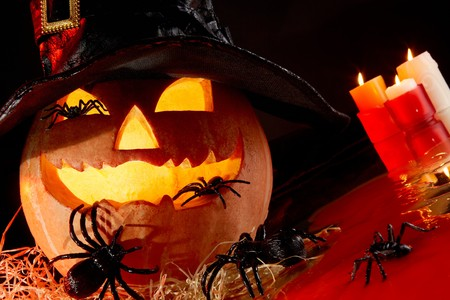 Image of Halloween pumpkin in hat with spiders on it photo