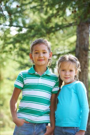 Portrait of happy lad and cute girl both looking at camera outdoors Stock Photo - 7796979