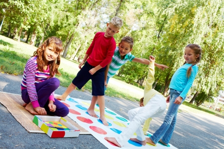 kid friendly: Portrait of happy friends playing outdoor game together